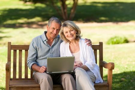 Senior couple working on their laptop photo