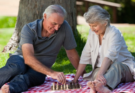 active life: Mature couple  picnicking in the garden
