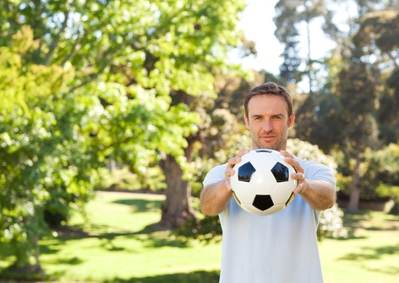 Handsome man with a ball photo