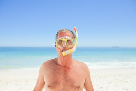Senior man with his mask and his snorkel Stock Photo