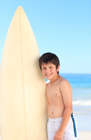 Boy with his surfboard Stock Photo