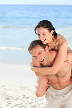 Woman with her husband on the beach photo