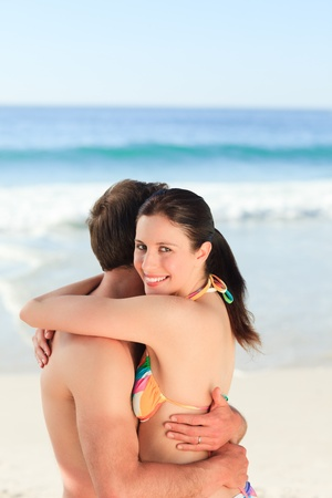 Lovely couple hugging on the beach photo