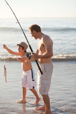 Father fishing with his son photo