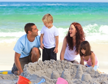 guy on beach: Radiant family at the beach