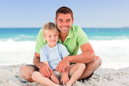 father's: Attentive father with his son at the beach