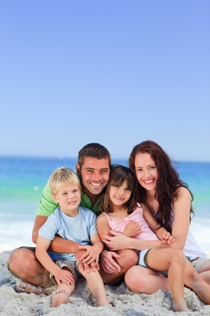 Portrait of a family at the beach photo