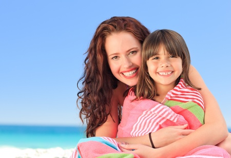 Smiling woman with her daughter in a towel Stock Photo