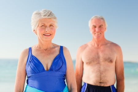 Elderly couple at the beach photo