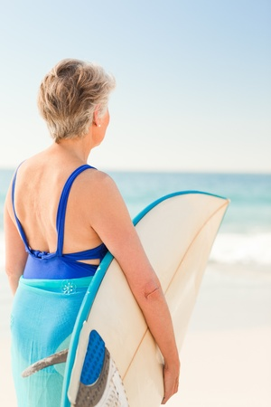 Woman with her surfboard at the beach photo