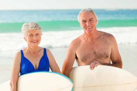 Couple with their surfboard on the beach Stock Photo - 10172548