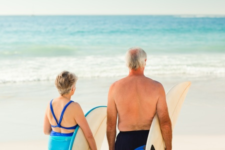 Couple with their surfboard on the beach photo