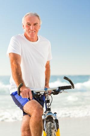Senior man with his bike photo