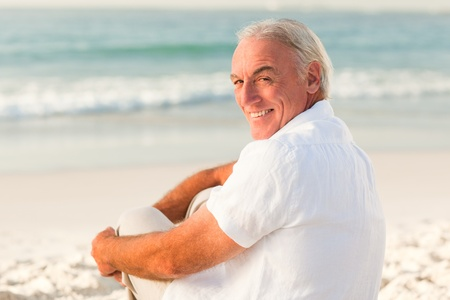 Man sitting on the beach photo