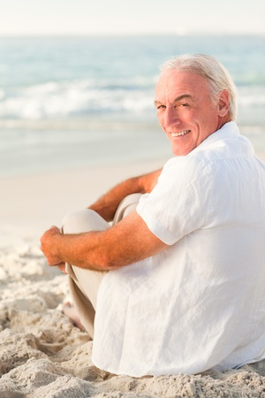 Man sitting on the beach photo