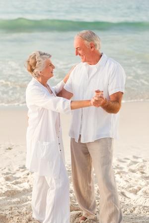 Elderly couple dancing on the beach Stock Photo - 10173126