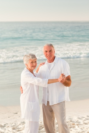 Elderly couple dancing on the beach Stock Photo - 10172330