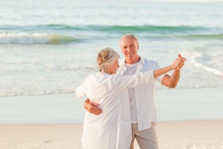 Senior couple dancing on the beach Stock Photo - 10171681
