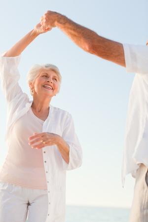 Senior couple dancing on the beach Stock Photo - 10164231