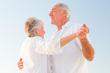 Senior couple dancing on the beach Stock Photo - 10174026