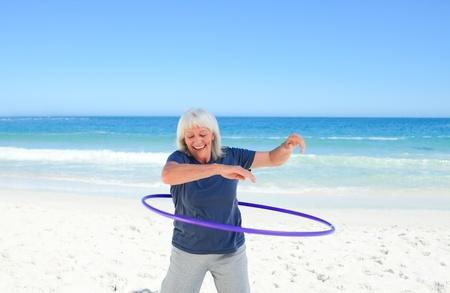 hula girl: Senior woman playing with her hoop Stock Photo