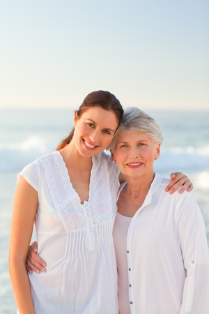 Smiling daughter with her mother photo