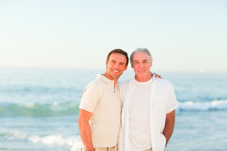 Father with his son at the beach photo
