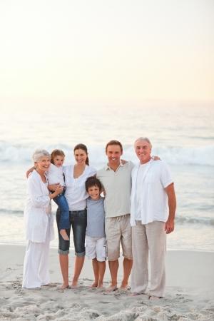 Beautiful family at the beach photo