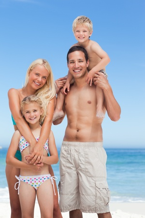 kids playing beach: Happy family on the beach
