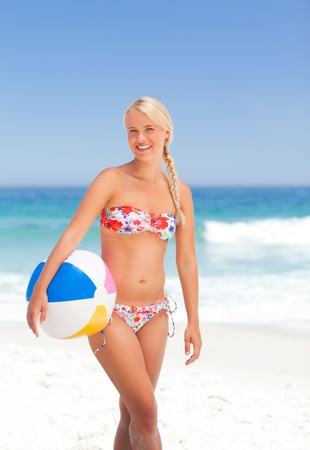 Woman with her ball on the beach photo