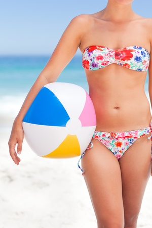 Woman with her ball on the beach Stock Photo - 10170929