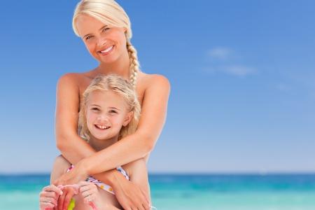 Beautiful mother embracing her daughter Stock Photo