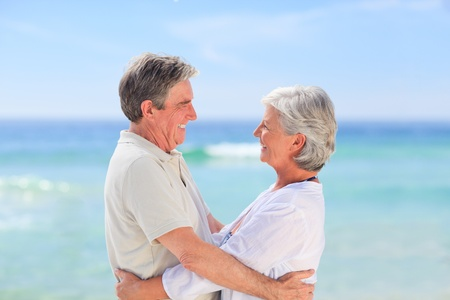 Elderly man embracing her wife Stock Photo - 10174745