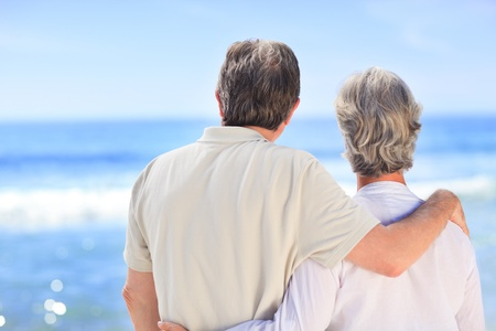 retired couple: Senior couple looking at the sea Stock Photo