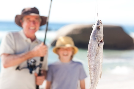 Man fishing with his grandson photo