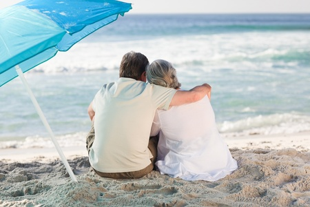Senior couple looking at the sea photo