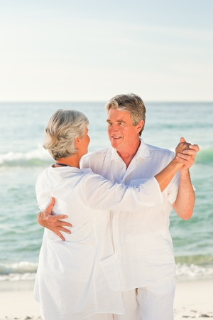 Elderly couple dancing on the beach Stock Photo - 10164344