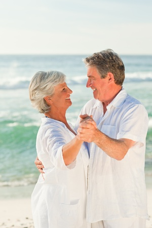 Mature couple dancing on the beach Stock Photo - 10171574