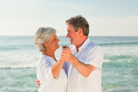 Mature couple dancing on the beach Stock Photo - 10172360