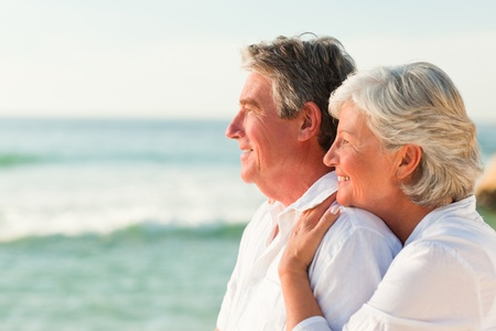 husbands: Woman hugging her husband at the beach Stock Photo