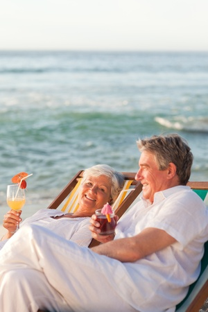 Retired couple drinking a cocktail Stock Photo - 10171590
