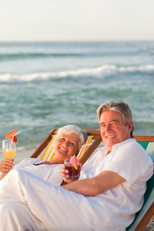 Retired couple drinking a cocktail photo