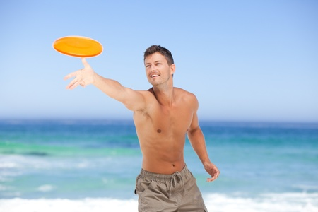 Man playing frisbee photo