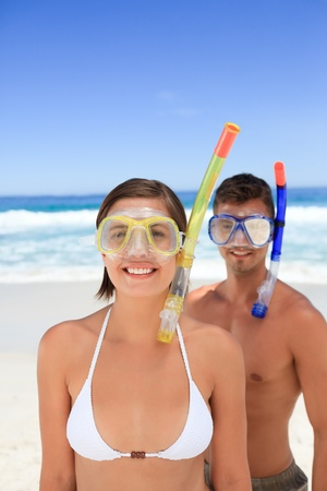 Couple with their mask at the beach photo