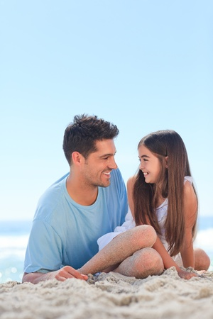 Father with his daughter at the beach photo