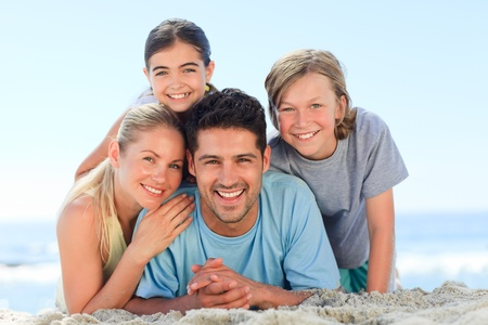 Portrait of a smiling famiy at the beach Stock Photo - 10183672