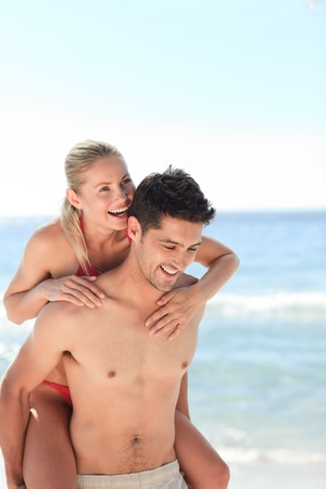 Beautiful man having girlfriend a piggyback photo