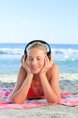 Radiant woman listening to some music Stock Photo - 10183904