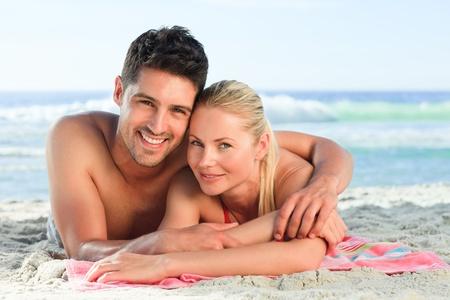 heterosexual couple: Lovers lying down on the beach