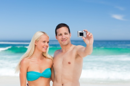 Couple taking a photo of themselves on the beach Stock Photo - 10184149